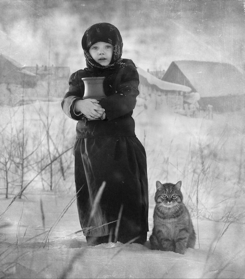 Girl and a cat (Russia) Unknown author.